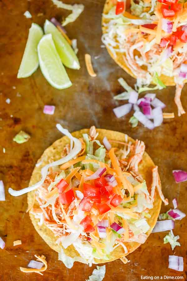 Crock pot chicken tostadas recipe gets dinner on the table fast for a great meal. This recipe is versatile and works for family dinner, parties and more.