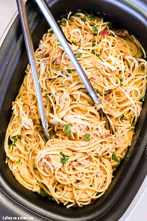 Crock Pot Cheesy Chicken Spaghetti Recipe is a creamy and delicious twist on traditional spaghetti. It is so easy to prepare and a tasty dinner idea.