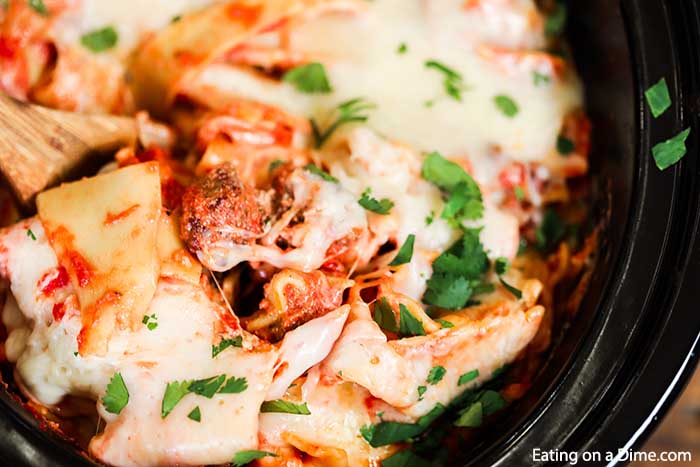 Slow Cooker Sausage Lasagna is a one pot dinner layered with meat, cheese, pasta and the best tomato sauce. Crockpot lasagna with broken noodles is so easy!