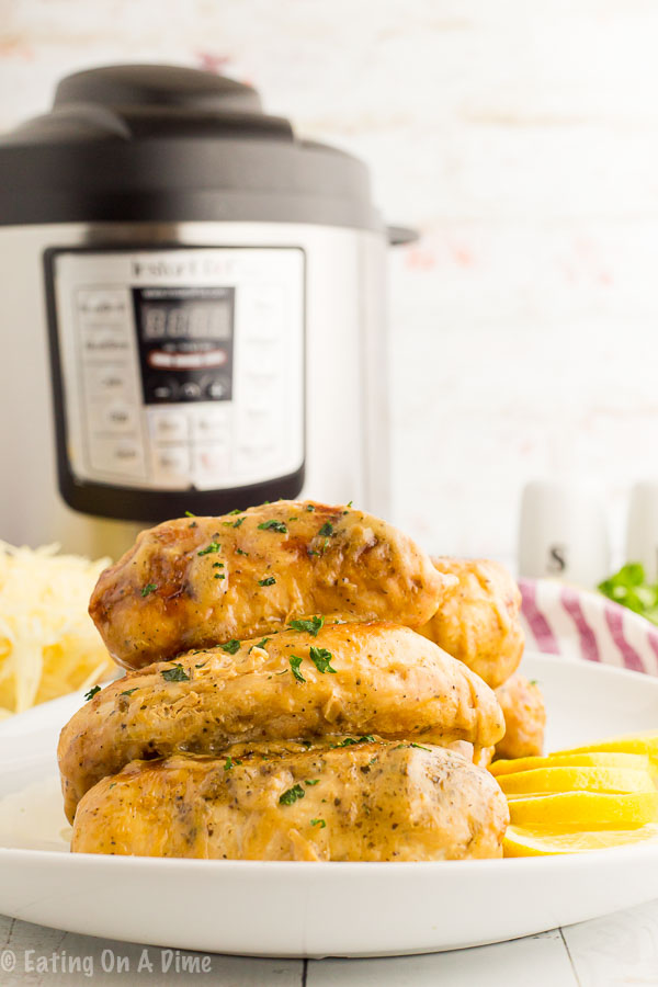 Instant Pot lemon chicken recipe gets dinner on the table in 30 minutes or less! The creamy sauce is so light and perfect to enjoy year round.