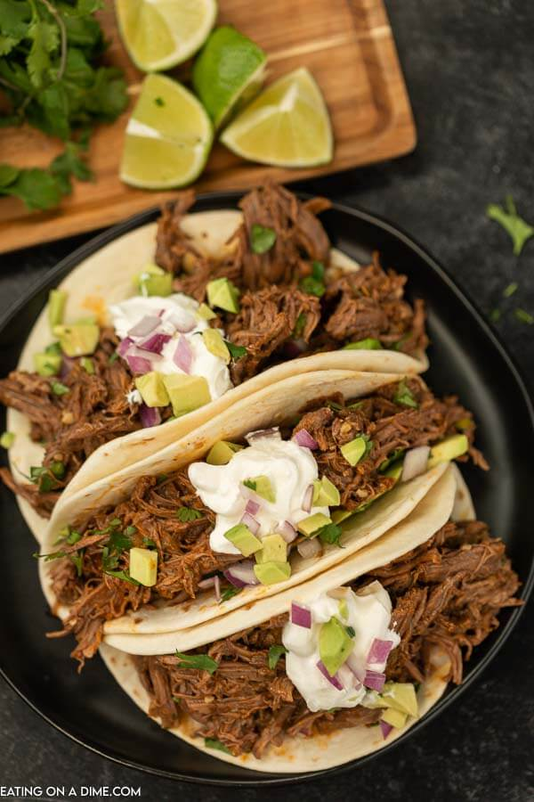 easy shredded beef tacos with limes