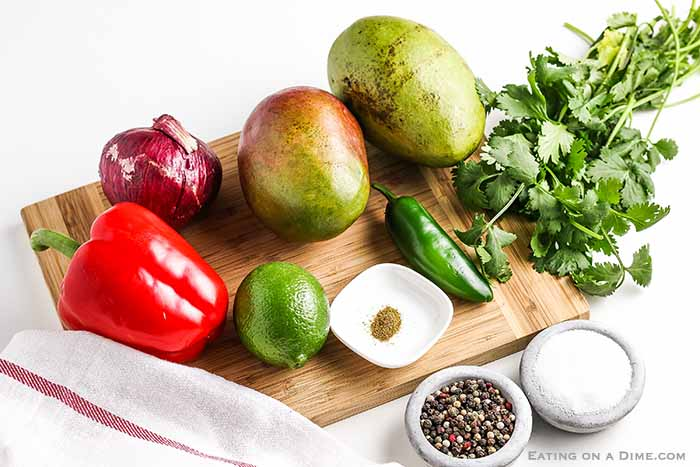 This easy Mango salsa recipe has the perfect combination of sweet and spicy. Enjoy mango salsa with your favorite Mexican dish, seafood or with tortilla chips. Fresh is best and you will love this mango salsa. #eatingonadime #mangosalsarecipe