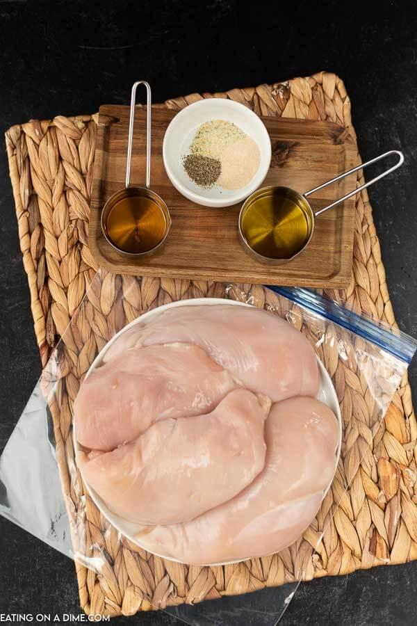Ingredients to make the best grilled chicken marinade: chicken breasts, apple cider vinegar, olive oil, garlic salt, onion powder and pepper.