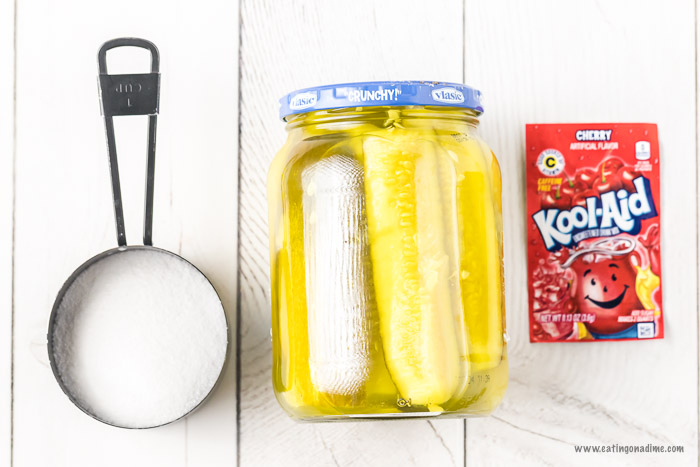 Kool aid pickles combine sweet and salty for an amazing flavor combination. With just 3 ingredients,this kool aid pickles recipe is super easy but so tasty. Learn how to make DIY cherry pickles. #eatingonadime #koolaidpickles