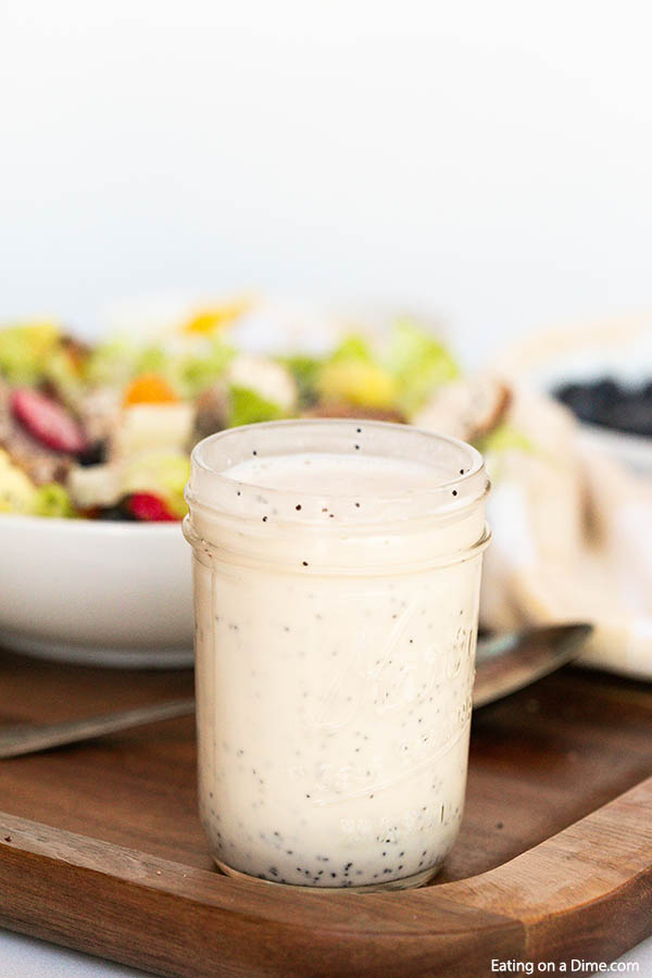 Poppyseed dressing recipe only has a few ingredients and takes just minutes to make. Skip the store bought salad dressing and make this delicious poppyseed dressing homemade recipe. Enjoy this creamy DIY Panera Poppyseed dressing at home. #eatingonadime #poppyseeddressingrecipe