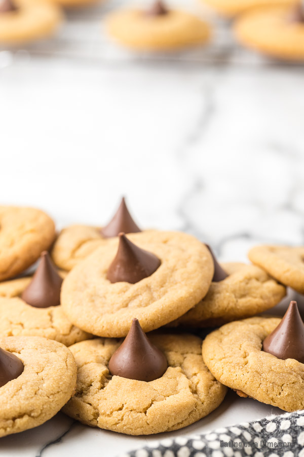 These Peanut Butter Kiss Cookiesare fun to make and taste delicious. You'll be surprised by how easy these are and everyone will love them!