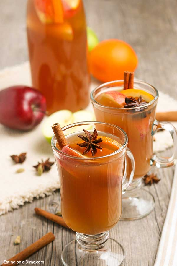 The cooler weather is perfect for Homemade apple cider recipe. It is easy to make from scratch and will make your house smell amazing. Learn how to make the best Homemade apple cider recipe on the stovetop. #eatingonadime #homemadeapplecider