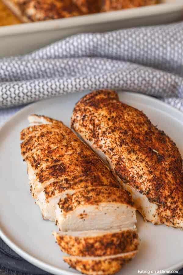 This easy baked chicken recipe has only a few ingredients and takes less than 30 minutes to bake in the oven. Learn how to bake chicken for an easy meal idea that is flavorful. Find out how to cook chicken for shredding, salads and more. How to bake chicken breast in oven. #eatingonadime #howtobakechicken #howtobakechickenintheoven #howtobakechickenintheovensimple #Intheovenhealthy #intheovenrecipes #intheovenjuicy #intheoveneasy