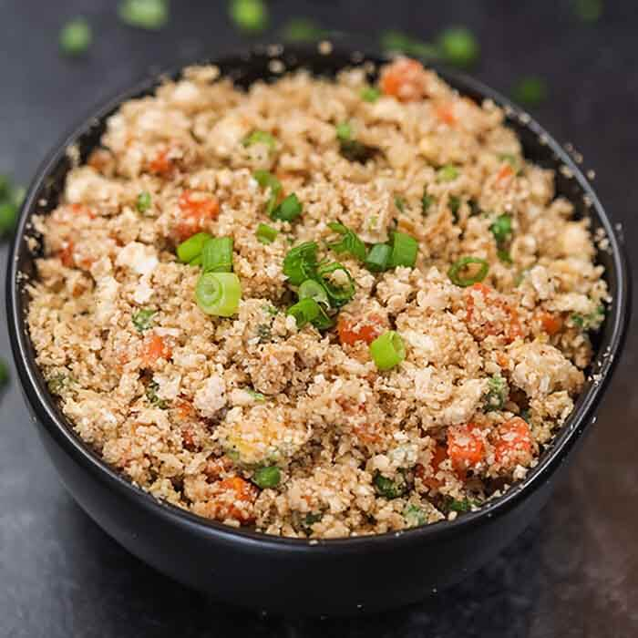Skip takeout and enjoy this easy Cauliflower fried rice recipe at home. This delicious recipe is keto friendly while being packed with flavor. Learn how to make the best keto low carb cauliflower fried rice with egg. #eatingonadime #cauliflowerfriedricerecipe #whole30 #RecipesEasy #RecipesHealthy #KetoEasy #healthy #recipes