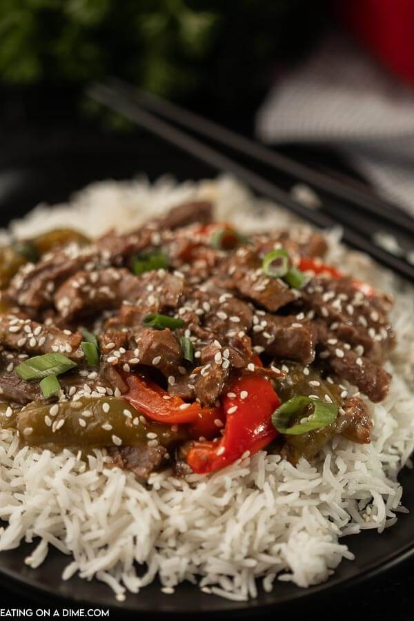 Need an easy crock pot recipe? This Crockpot Pepper Steak Recipe is delicious! Easy to make slow cooker pepper steak recipe is simple to make. The entire family will loved this Chinese pepper steak recipe made in the crock pot! #eatingonadime #peppersteak #chineserecipes #crockpotrecipes #slowcookerrecipes