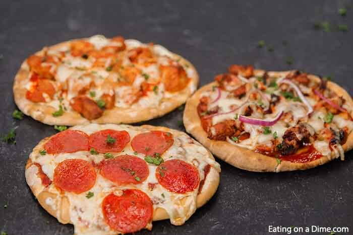 Enjoy this healthy Pita pizza recipe in minutes with the toppings of your choice. Skip takeout and make pita bread pizza for a quick and easy frugal dinner. Enjoy homemade mini pizza in the oven in minutes. The ideas are endless for pita pizza recipes and include buffalo chicken, BBQ Chicken and more. Kids love flatbread and pita pizza recipes. #eatingonadime #pitapizza #RecipesKids #healthycleaneating #lowcalorie