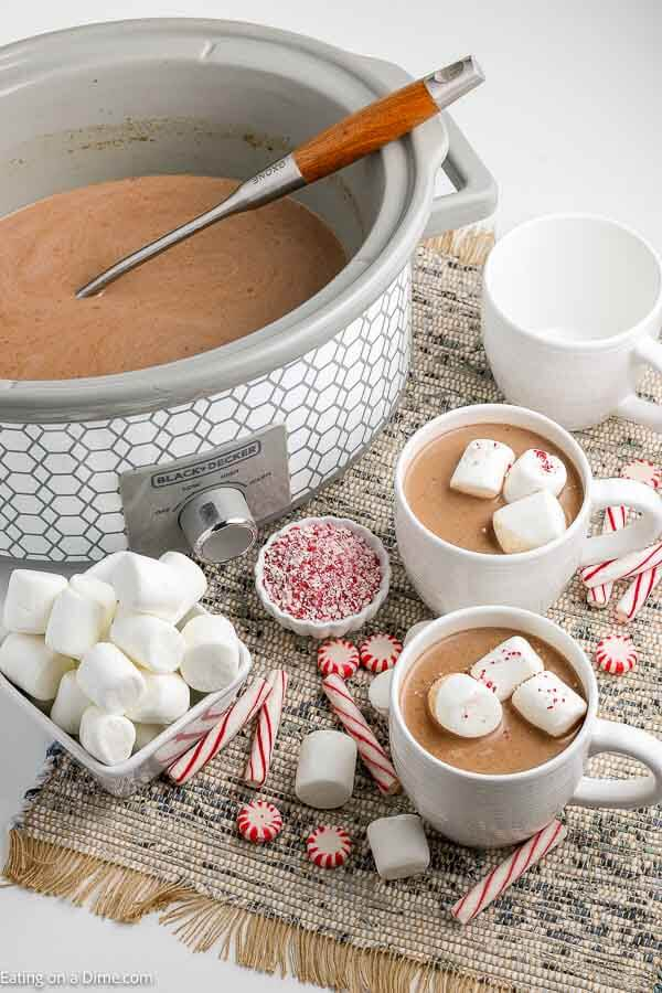 Crock pot hot chocolate recipe is rich and creamy with just 5 simple ingredients. Serve this decadent drink for parties, Christmas and more!Crock pot hot chocolate recipe is the best drink for a crowd and so easy in the slow cooker. Serve homemade hot cocoa for the holidays. #eatingonadime #crockpothotchocolate #RecipeSlowCooker #Foracrowdeasyrecipes #easyfast #withpackets #cocoapowder