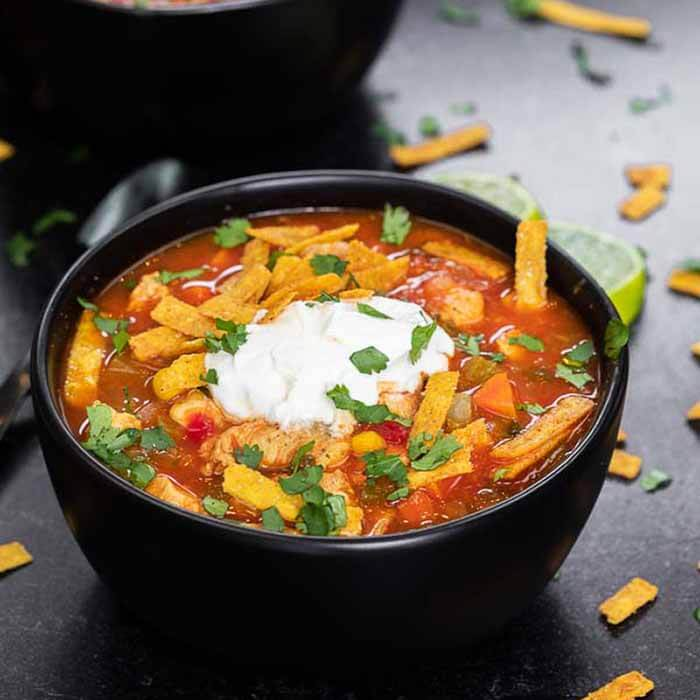 Stretch your meat budget with this tasty and authentic Mexican chicken soup recipe. There is so much flavor and a little bit of heat for an amazing soup. Learn how to make this easy to make restaurant style tex mex soup on the stove top. #eatingonadime #mexicanchickensoup #mexicanchickensoupcaldodepollo #Recipeshomemade #Mexico #simple #heatlhy