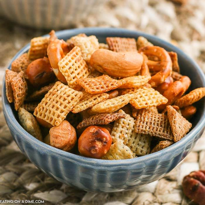 Chex party mix recipe is a delicious appetizer and snack around here. We make this homemade Chex mix with Worcestershire sauce for holidays, Game Day, birthdays and more. It is easy and frugal. Learn how to make this traditional, savory Chex party mix recipe. This original Chex mix recipe is the best! #eatingonadime #snackrecipes #chexmixrecipes #appetizerrecipes