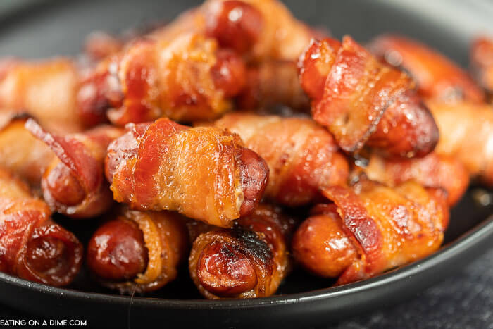 Close up image of bacon wrapped lil smokies.