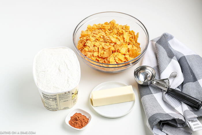 Ingredients to make fried ice cream: ice cream, corn flakes cereal, butter, cinnamon and an ice cream scoop