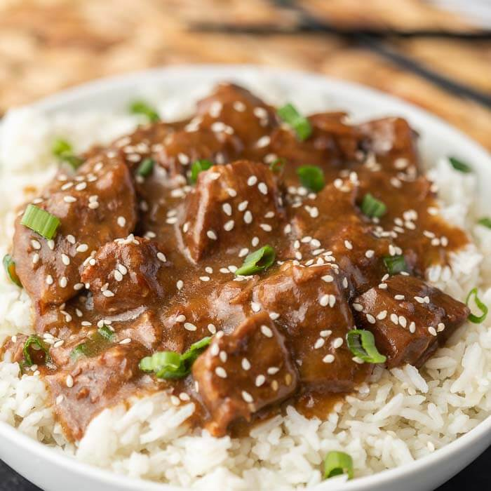 Teriyaki Beef over rice topped with sesame seeds and green onions