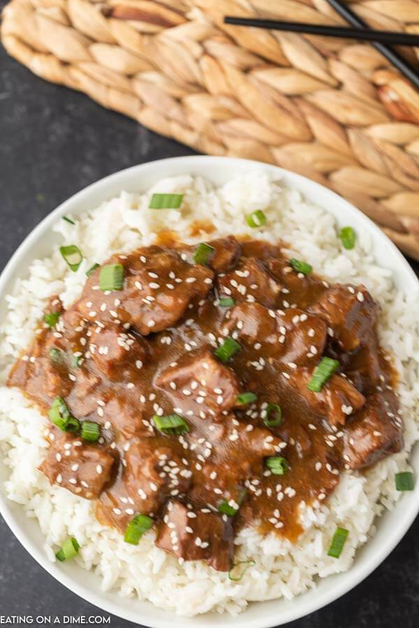 Instant Pot Teriyaki Beef over rice topped with green onions