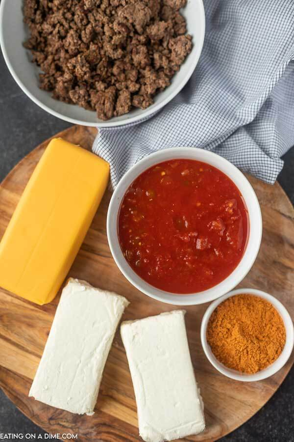 ingredients for taco dip: ground beef, salsa, cream cheese, velveeta cheese and taco seasoning.