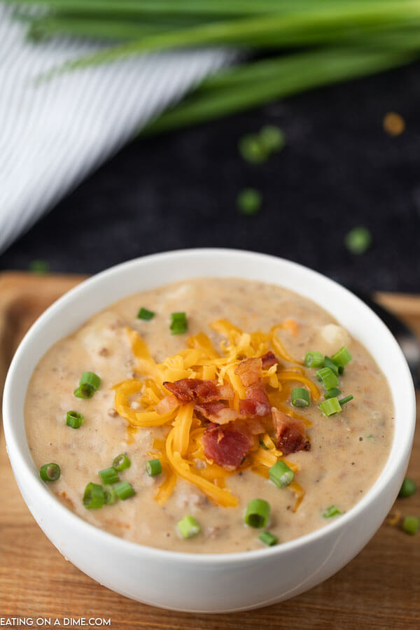 bowl of cheesebueger soup topped with bacon cheese and green onion