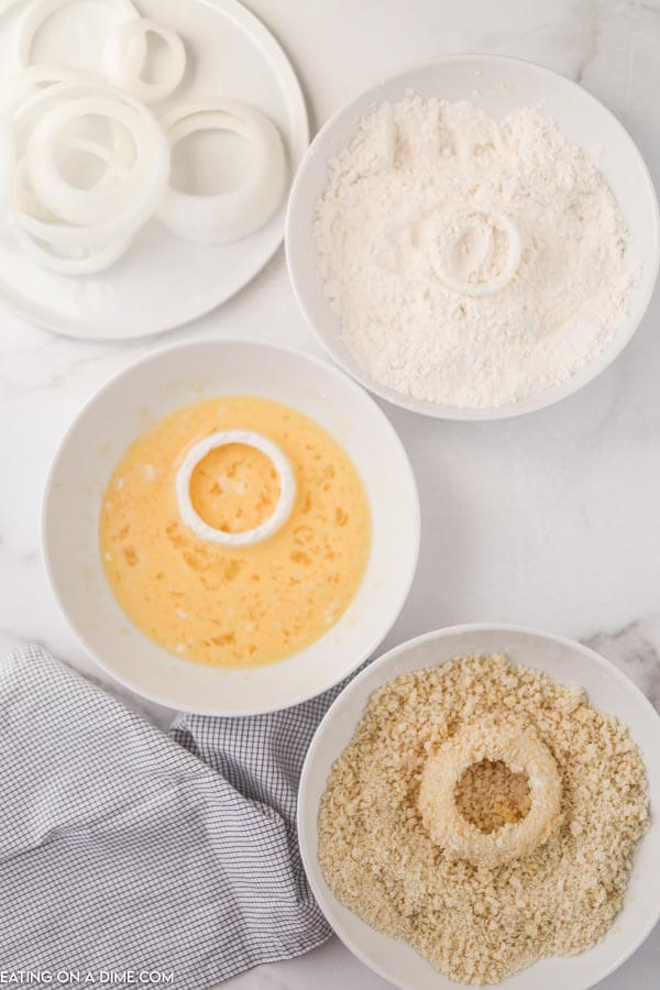 3 bowls for dipping onion rings before frying