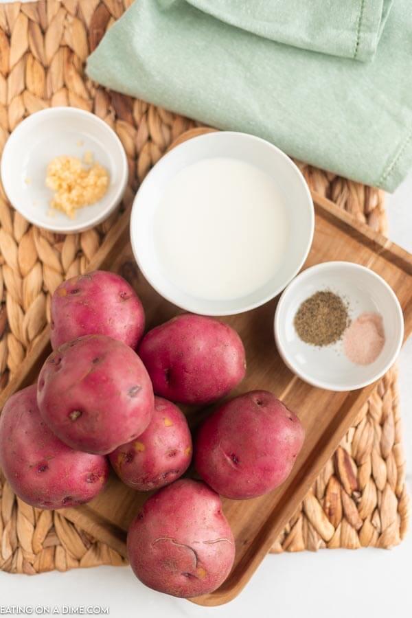 ingredients for recipe: garlic, milk, seasoning. red potatoes