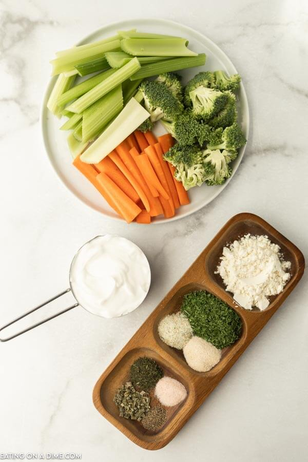 ingredients for recipe- sour cream, buttermilk powder, seasoning, vegetables for dipping.