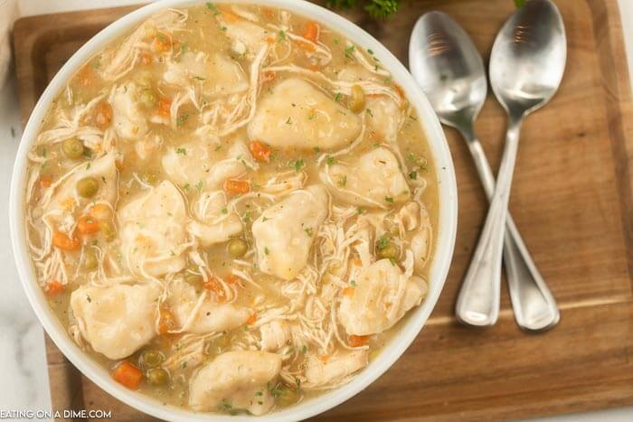 bowl of chicken and dumplings on a tray