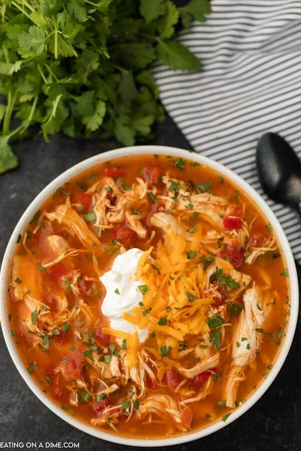 Close up image of a bowl of chicken fajita soup in a white bowl.