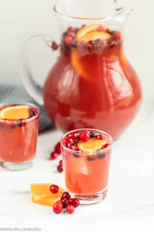 glass pitcher of punch and two glasses