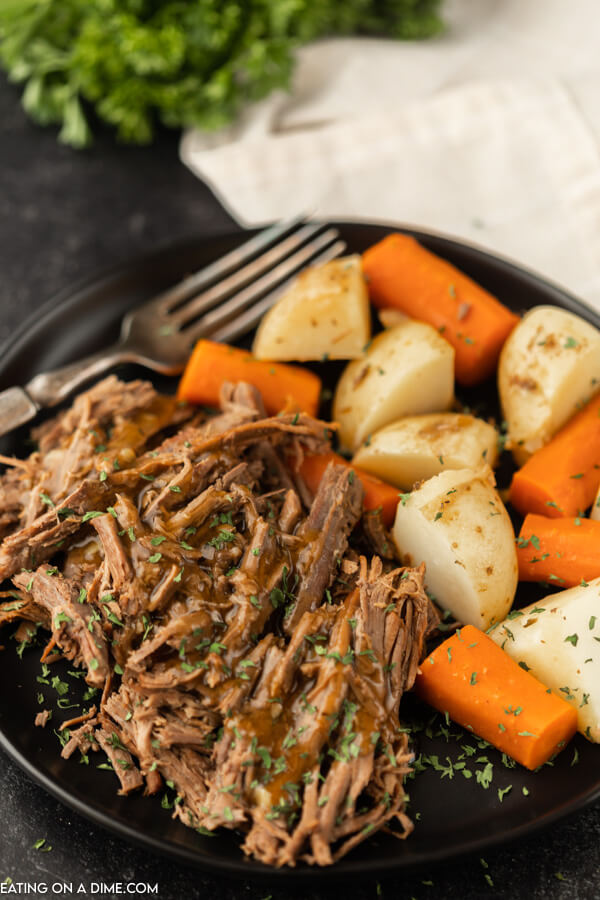plate of roast, potatoes and carrots