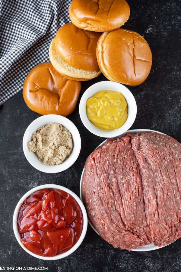 Close up image of ingredients for sloppy joes. It includes hamburger buns, uncooked ground beef, mustard, brown sugar and ketchup.