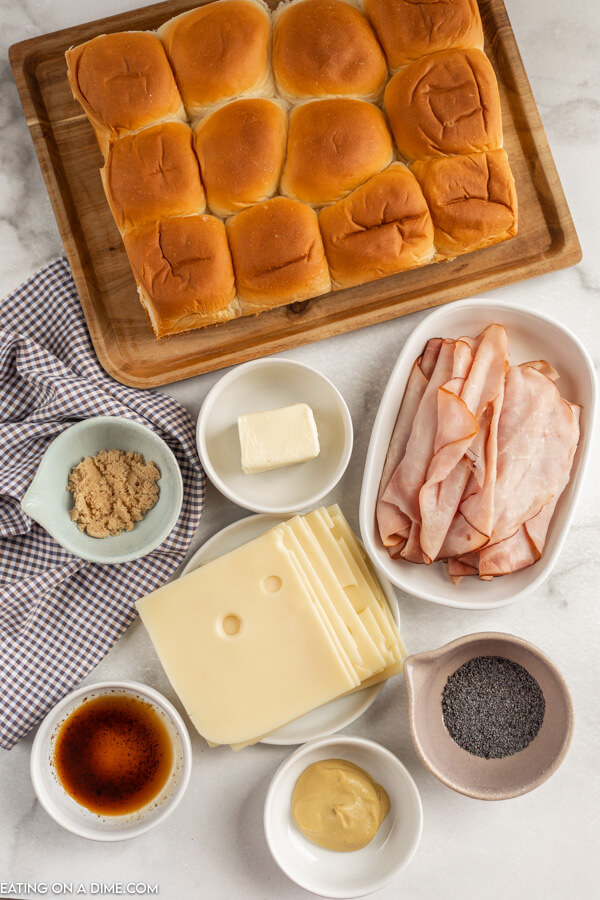 Close up image of the ingredients for ham and cheese sliders.