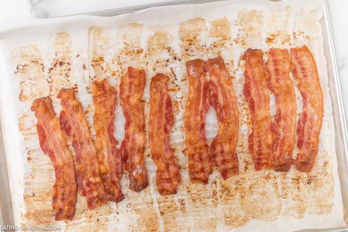 cooked bacon slices on baking sheet