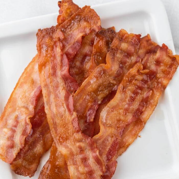 cooked bacon slices on plate