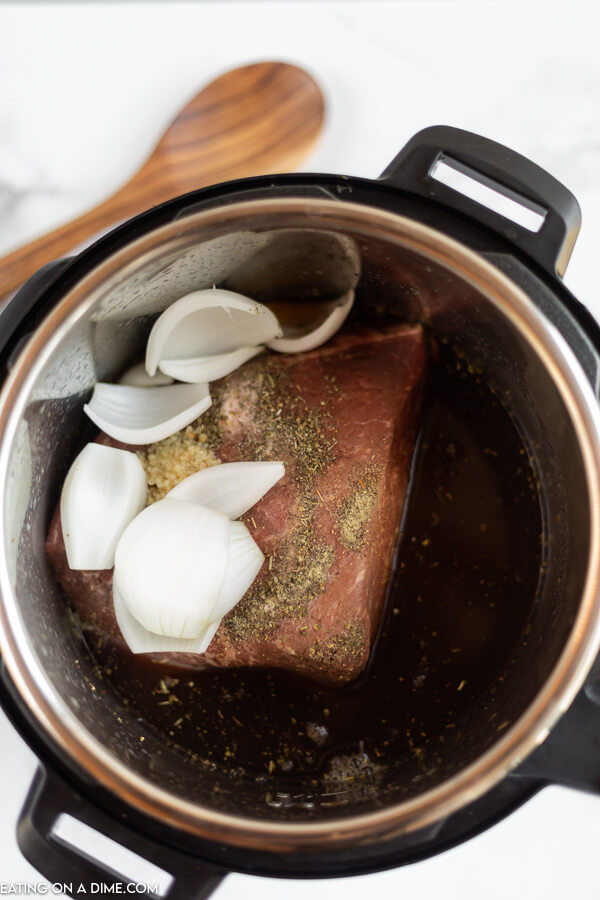 Instant pot with ingredients ready to cook.