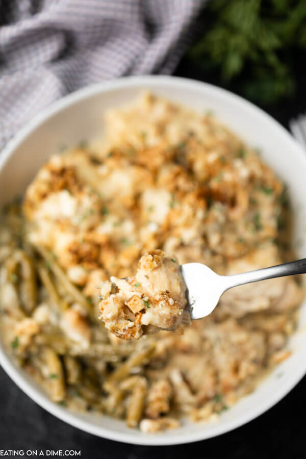 Close up image of a bowl of chicken and stuffing with a fork.