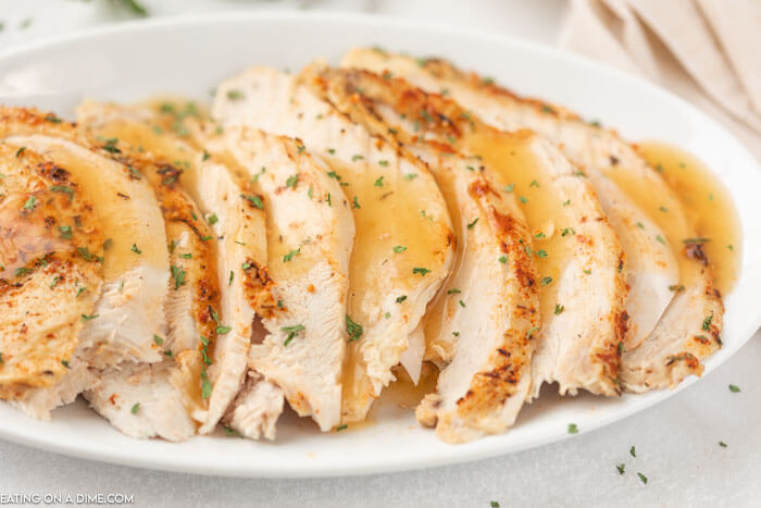 sliced turkey breast on platter with gravy