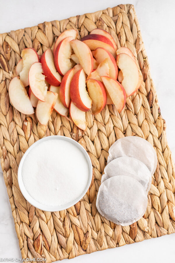 Close up of ingredients for the peach tea on a platter.