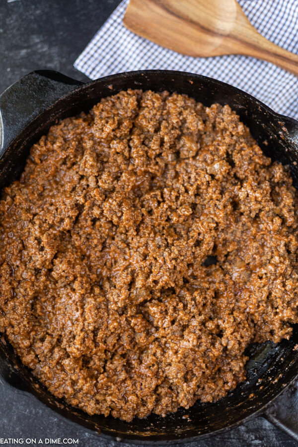 Close up image of sloppy joes in a cast iron pan.