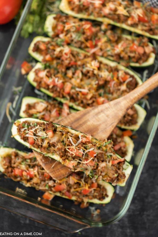 zucchini boars in serving diwh with serving spoon