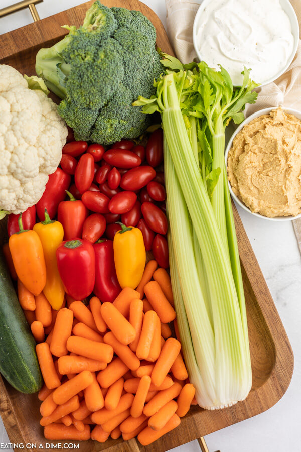ingredients for vegetable tray: dip and assorted vegetables.