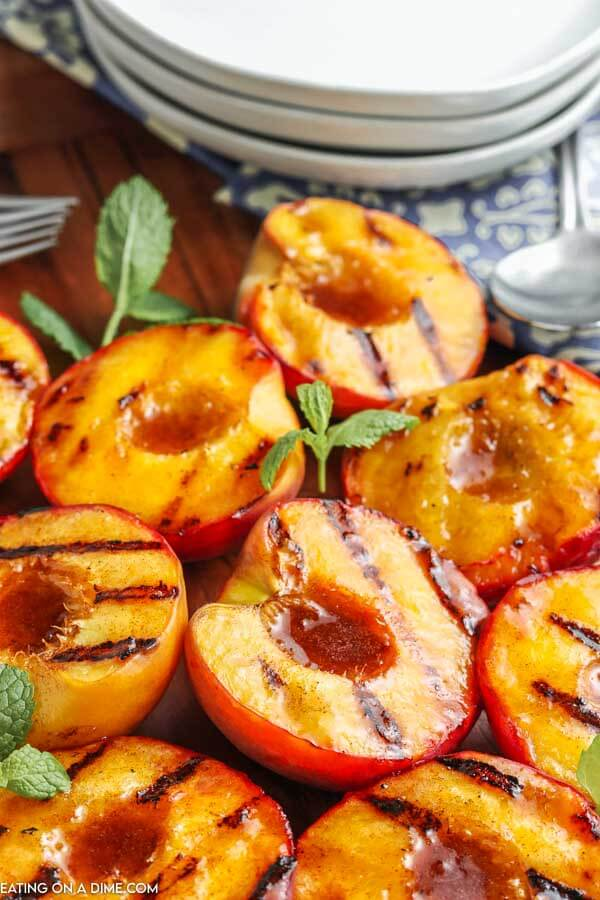 grilled peaches on cutting board