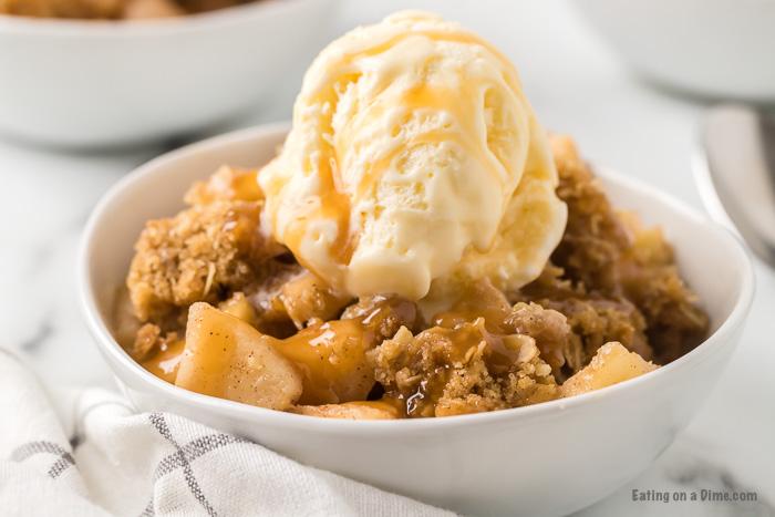 bowl of apple crisp with ice cream