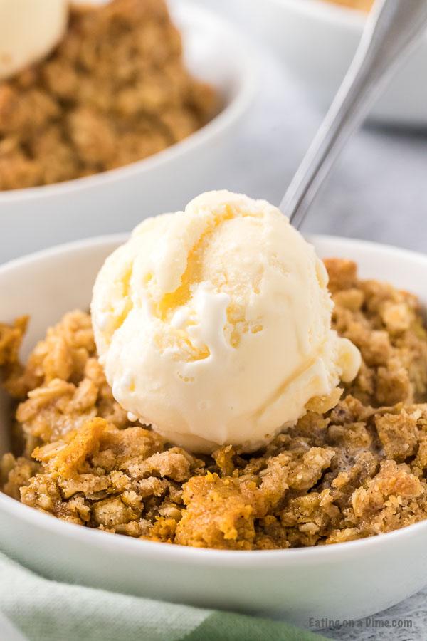 bowl of pumpkin crisp with ice cream on top