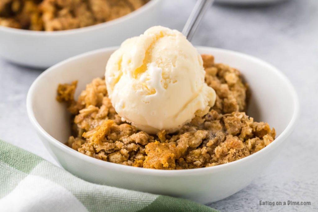 bowl of pumpkin crisp with ice cream