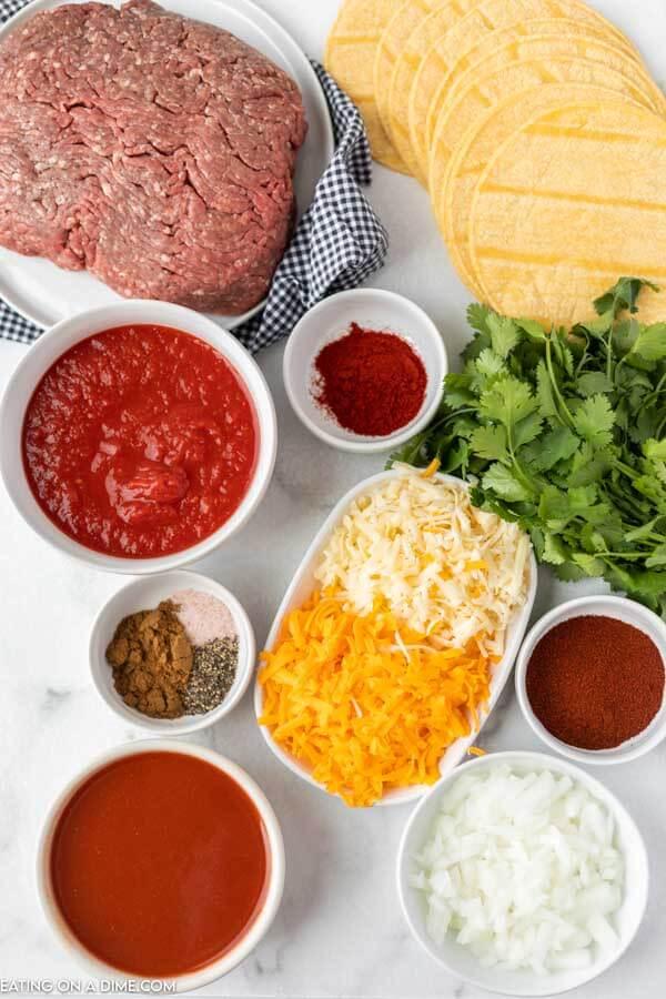 ingredients for recipe: ground beef, corn tortillas, cheese, seasoning, onion.