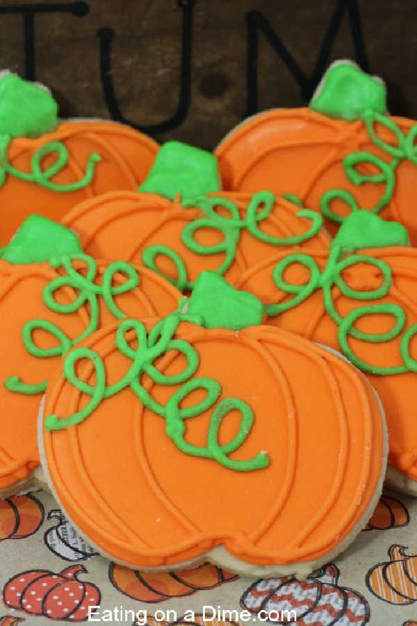 Close up image of decorated pumpkin shaped cookies.