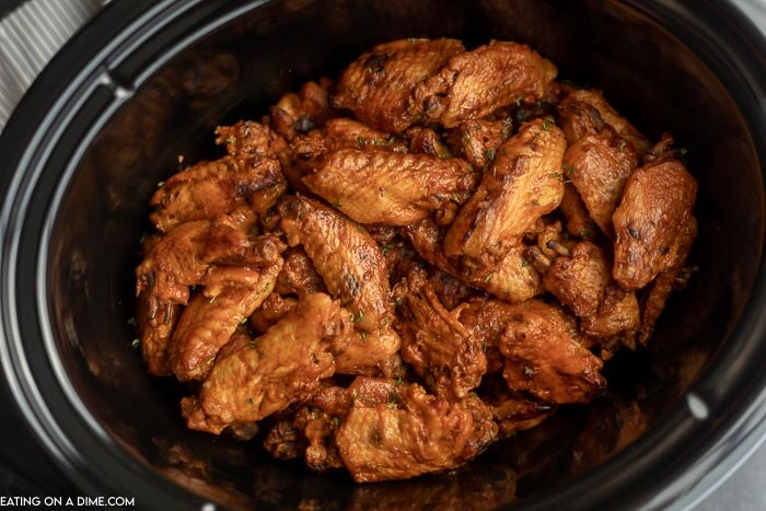 Crock pot of cooked chicken wings.