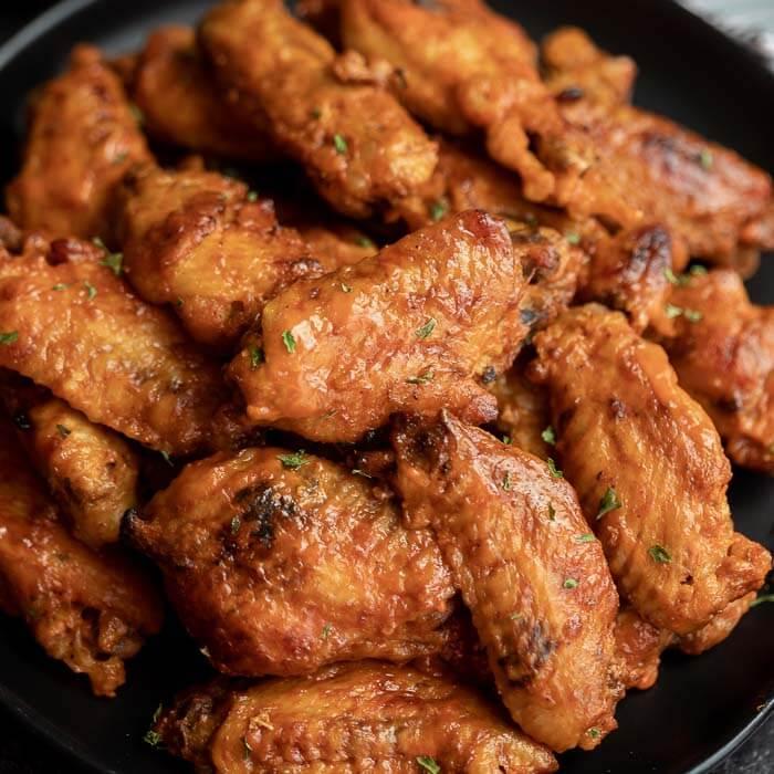 Platter of chicken wings on a platter.